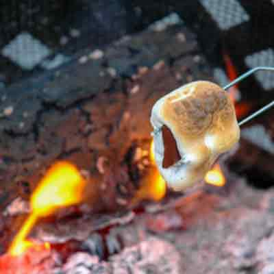 S'more around the campfire. A great finish for a zipline adventure